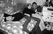 Ivor, Nikky and Lorp in bedroom at Hawthorne Road, UK, 1980s.