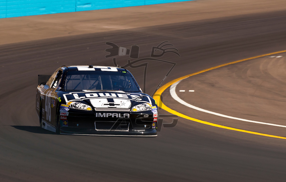 AVONDALE, AZ - MAR 03, 2012:  Jimmie Johnson (48) brings his NASCAR Sprint Cup car through turn 4 during qualifying for the Subway Fresh Fit 500 race at the Phoenix International Raceway in Avondale, AZ.