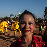 Where: Island of Madura, Indonesia. A dance festival just before the famous bull races. What a beautiful girl. I love the way she looks directly into the camera.