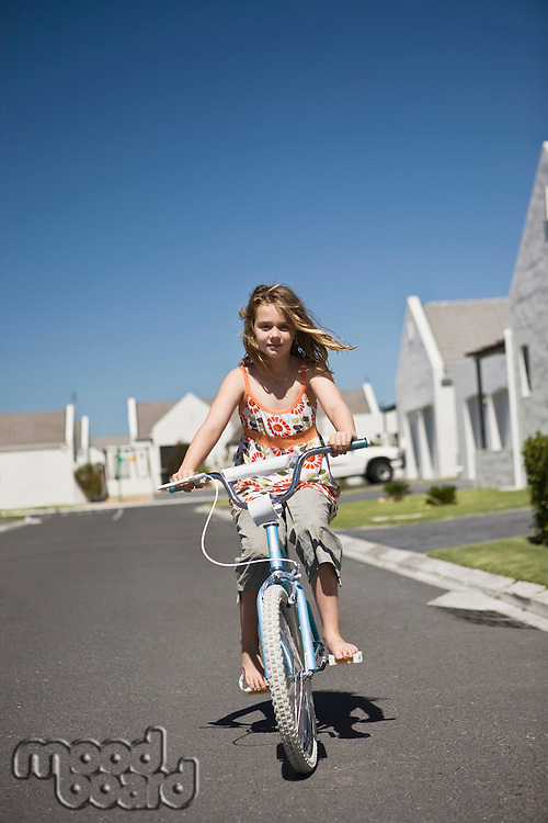 South Africa Cape Town girl riding bicycle on street