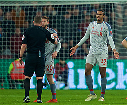 LONDON, ENGLAND - Monday, February 4, 2019: Liverpool's Joel Matip is shown a yellow card by referee Kevin Friend during the FA Premier League match between West Ham United FC and Liverpool FC at the London Stadium. (Pic by David Rawcliffe/Propaganda)