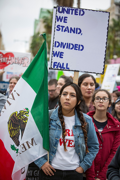 Immigrants rights advocates protest President Donald Trump and his anti-immigrant policies which include ICE raids and proposed bans on immigrants coming into the country. Protest in the streets of Los Angeles of Presidents Day weekend.