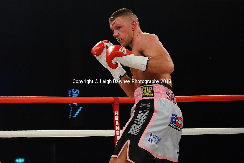 Chris Jenkinson (pictured) during jis bout against Adam Battle in a Light Middleweight contest. Glow, Bluewater, Kent, UK. Hennessy Sports © Leigh Dawney Photography 2013.