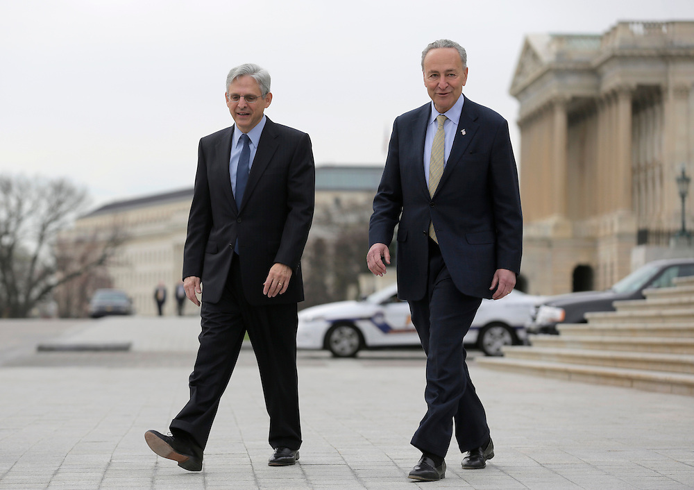 Senator Charles Schumer (D-NY)(R) walks with Judge Merrick Garland, President Obama's Supreme Court nominee, on Capitol Hill in Washington March 22, 2016.      REUTERS/Joshua Roberts
