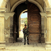 Central America, Guatemala, Antigua. A military guard at a government building in Antigua, Guatemala.