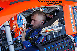 ROSEBURG, OR - AUGUST 27: Ryan Partridge driver of the #9 Sunrise Ford/Eibach Spring/Lucas Oil Ford sits in his car during practice for the NASCAR K&N Pro Series West Toyota/NAPA Auto Parts 150 at the Douglas County Speedway on August 27, 2016 in Roseburg, Oregon. (Photo by Jason O. Watson/NASCAR via Getty Images) *** Local Caption *** Ryan Partridge
