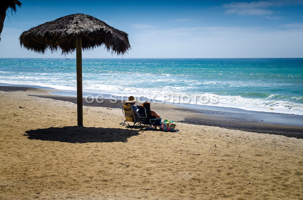 Couple Sitting on The Beach in San Clemente