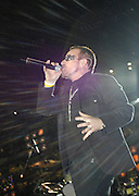 "Lead singer of U2 and  political activist Bono performs prior to the Atlanta Falcons-New Orleans Saints football game at the newly re-opened Louisiana Superdome in New Orleans, LA. on Monday, Sept. 25, 2006. Bono sang ""it's a Beautiful Day"" to the sold out arena.(Photo/Suzi Altman)"