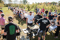 "Local Eatery Chef Kevin Halligan and his crew serve up ""Breakfast in the Orchard"" to approximately 100 guests featuring fresh donuts, maple sage sausage and bacon, apple walnut bread pudding, ham, cheddar and apple omelet and chicken sage and arugala sweet potato hash at Smith's Apple Orchard in Belmont.    (Karen Bobotas/for the Laconia Daily Sun)"