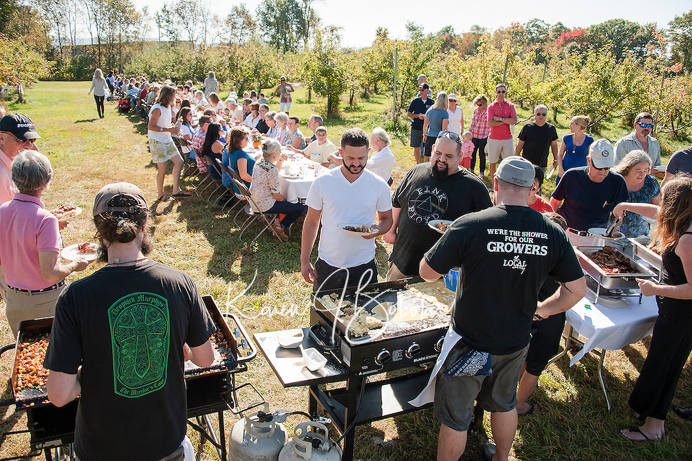 """Local Eatery Chef Kevin Halligan and his crew serve up """"Breakfast in the Orchard"""" to approximately 100 guests featuring fresh donuts, maple sage sausage and bacon, apple walnut bread pudding, ham, cheddar and apple omelet and chicken sage and arugala sweet potato hash at Smith's Apple Orchard in Belmont.    (Karen Bobotas/for the Laconia Daily Sun)"""