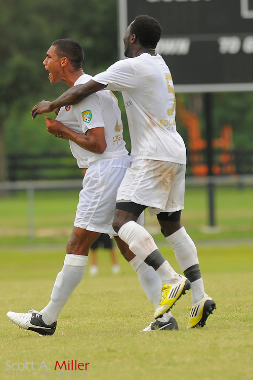 Orlando City defender Sean Reynolds (21) celebrates his goal with defender Joseph Toby (5) during City's 4-1 win over the Austin Aztex in the PDL Southern Conference Championships final at Trinity Catholic High Schooll on July 22, 2012 in Ocala, Florida. ..©2012 Emily A. Miller