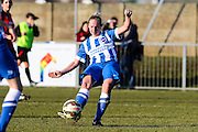 Jay Blackie passes the ball during the FA Women's Sussex Challenge Cup semi-final match between Brighton Ladies and Hassocks Ladies FC at Culver Road, Lancing, United Kingdom on 15 February 2015. Photo by Geoff Penn.