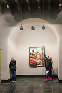 Nederland, Den Bosch, 20160324.<br /> Bezoekers, veel leerlingen van scholen, bezoeken de permanente tentoonstelling met de werken van Jheronimus Bosch.<br /> Het Jheronimus Bosch Art Center in de  voormalige Sint-Jacobskerk.<br /> Het Jheronimus Bosch Art Center stelt permanent alle werken van de laatmiddeleeuwse schilder Jheronimus Bosch ten toon. Het gaat hier niet om originele panelen maar om hoogwaardige fotoreproducties op ware grootte afgedrukt. <br /> <br /> Netherlands,  Den Bosch, 20160324.<br /> Visitors, many students of schools, visit the permanent exhibition of the works of Hieronymus Bosch.<br /> The Hieronymus Bosch Art Center in the former St. James.<br /> The Hieronymus Bosch Art Center proposes permanent all works of the late medieval painter Hieronymus Bosch on display. It is not original panels but printed at full size photo-quality prints.