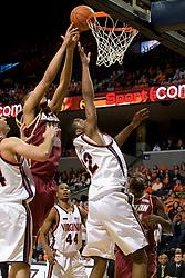 Boston College center Tyrelle Blair (44) jumps over Virginia forward Jamil Tucker (12) for a rebound.  The Virginia Cavaliers men's basketball team defeated the Boston College Golden Eagles 84-66 at the John Paul Jones Arena in Charlottesville, VA on January 19, 2008.