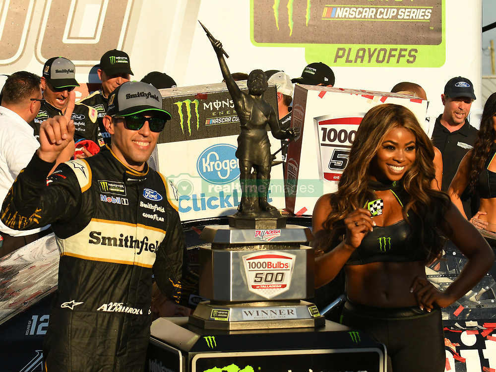 October 14, 2018 - Talladega, AL, U.S. - TALLADEGA, AL - OCTOBER 14: Aric Almirola, Stewart-Haas Racing, Ford Fusion Smithfield Bacon For Life (10) celebrates in Victory Lane with Monster Girl Mariel Lane after winning the 1000Bulbs.com 500 on October 14, 2018, at Talladega Superspeedway in Tallageda, AL.(Photo by Jeffrey Vest/Icon Sportswire) (Credit Image: © Jeffrey Vest/Icon SMI via ZUMA Press)
