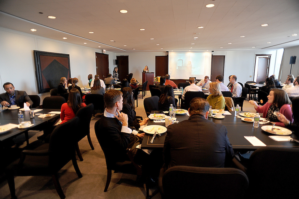 Photo By Michael R. Schmidt- December 12, 2012.The crowd gathered eats lunch as they listen to the awards presentation led by Amanda Groves, Partner, Diversity Committee Chair 2008-2012 - Winston & Strawn LLP Wednesday afternoon in Chicago. The presentation was the awards ceremony for the firms participation in the statewide mentoring program under the auspices of the Illinois Supreme Court.