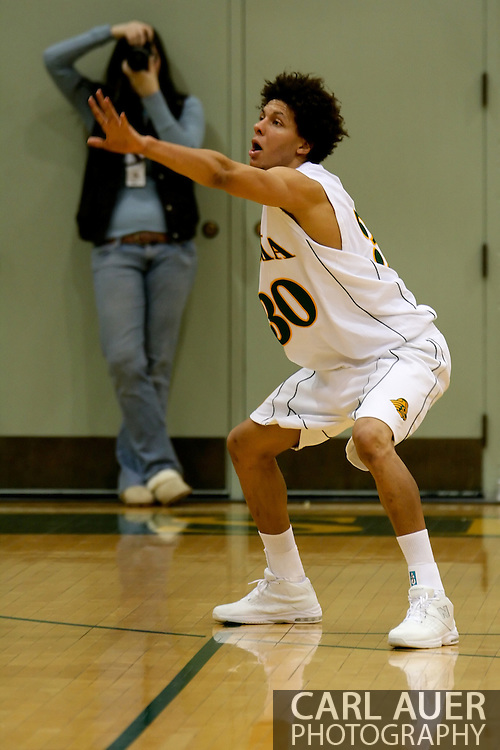 1/13/2006: Sophomore forward Cameron Burney (30) of the UAA Seawolves plays defense as Alaska Anchorage comes back to beat Northwest Nazarene, 60-57, in men?s basketball action at the Wells Fargo Sports Complex on Saturday.