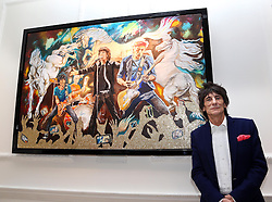 Ronnie Wood with his new painting Electric Horses at the opening of a new exhibition of his work at the Castle Fine Art  gallery in Mayfair, London, Thursday, 11th April 2013 Photo by: Stephen Lock / i-Images