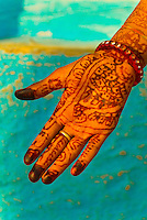 A woman's hand with mehndi design (henna hand painting), Bishnoi tribal village, near Rohet, Rajasthan, India