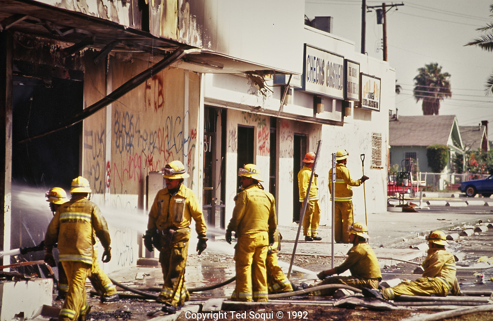 LA Fire Department putting out fires set by rioters in South Central LA.