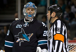January 21, 2010; San Jose, CA, USA; San Jose Sharks goalie Evgeni Nabokov (20) talks with referree Dan O'Halloran during the first period against the Anaheim Ducks at HP Pavilion.  San Jose defeated Anaheim 3-1. Mandatory Credit: Jason O. Watson / US PRESSWIRE
