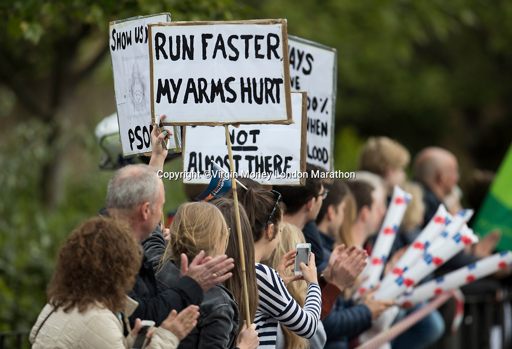 Spectators hold up signs. The Virgin Money London Marathon, 23rd April 2017.<br /> <br /> Photo: Jed Leicester for Virgin Money London Marathon<br /> <br /> For further information: media@londonmarathonevents.co.uk