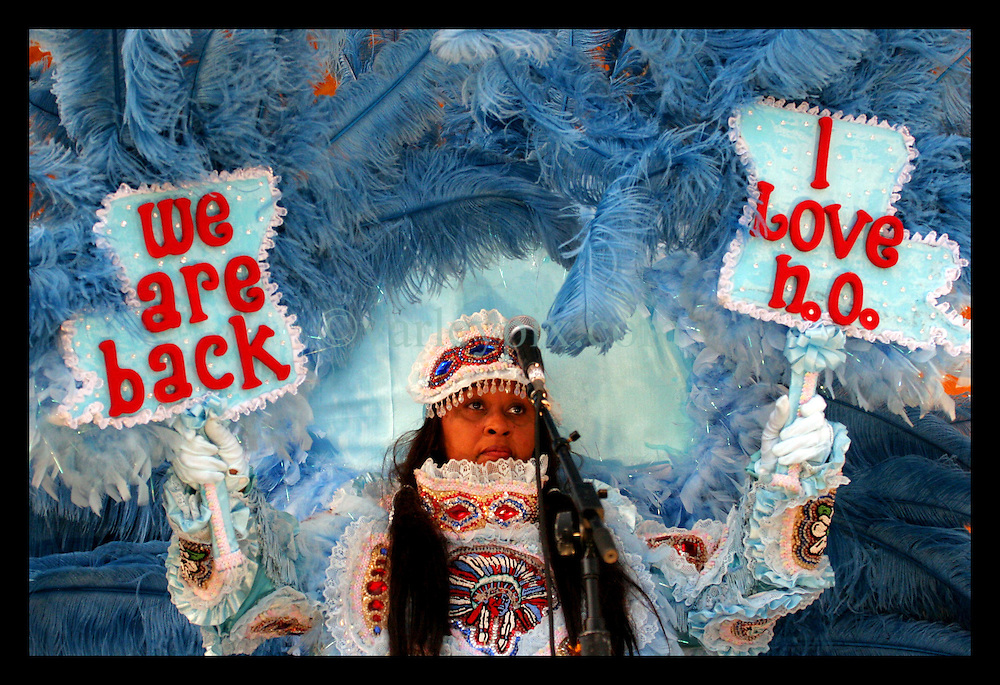 May 7th, 2006. New Orleans, Louisiana. Jazzfest . The New Orleans Jazz and Heritage festival. A Mardi Gras Indian with the band Big Chief Bo Dollis and and the Wild Magnolias Mardi Gras Indians on the Acura stage. Her messages are loud and clear - 'We are back,' and 'I love New Orleans.'