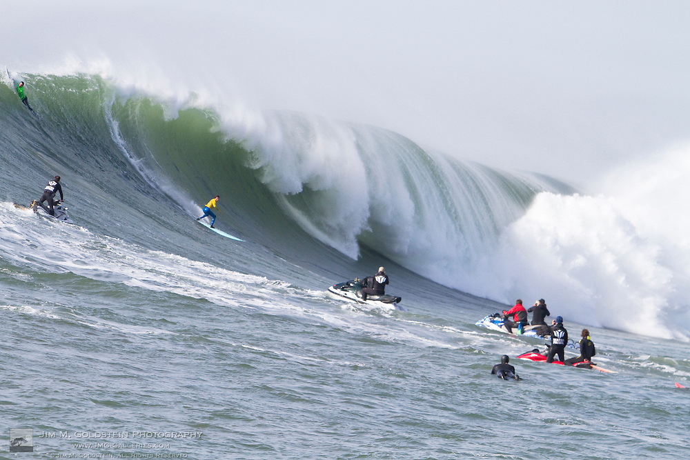 2nd place finisher Shane Desmond surfs a giant wave in the final round of the 2010 Mavericks Surf Contest held in Half Moon Bay, California on February 13, 2010