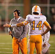 Nov 12, 2011; Fayetteville, AR, USA;  Tennessee Volunteers head coach Derek Dooley walks on the field next to quarterback Justin Worley (14) during a game against the Arkansas Razorbacks at Donald W. Reynolds Razorback Stadium. Arkansas defeated Tennessee 49-7. Mandatory Credit: Beth Hall-US PRESSWIRE