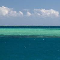 Oceania, Fiji, Mamanuca Islands. Waves break on horzion of Malolo Barrier Reef.