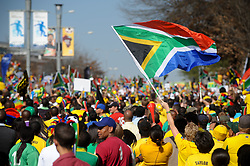Jun. 09, 2010 - Johannesburg, Gauteng, South Africa - A South African flag is waved above the crowd at the 'United We Shall Stand' rally for the South African national soccer team, Bafana Bafana. South Africa is hosting the FIFA World Cup, which begins June 11. (Credit Image: © Mark Sobhani/ZUMApress.com)