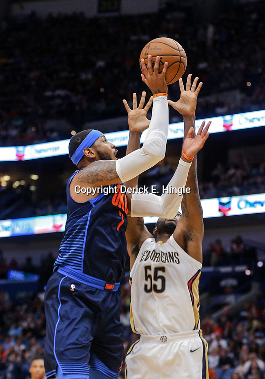 Apr 1, 2018; New Orleans, LA, USA; Oklahoma City Thunder forward Carmelo Anthony (7) shoots over New Orleans Pelicans forward E'Twaun Moore (55) during the first quarter at the Smoothie King Center. Mandatory Credit: Derick E. Hingle-USA TODAY Sports