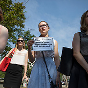 WASHINGTON,DC-JUL13: Una Corbett (center), a student at Harvard who is interning at the Feminist Majority Foundation this summer, at a rally for survivors of sexual assault and their allies, outside the Department of Education, ahead of a series of meetings that Secretary Betsy DeVos is holding with survivors, advocates for the wrongly accused and college administrators. DeVos is considering whether to rollback Obama-era guidance on handling sexual assault, which victims' advocates credit with improving the situation on college campuses, and which others say has led schools to err on the side of finding students guilty of assault even when they are innocent. (Photo by Evelyn Hockstein/For The Washington Post)