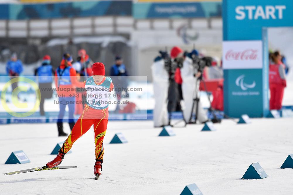 DU Haitao CHN LW5/7 competing in the ParaSkiDeFond, Para Nordic Skiing, 20km at  the PyeongChang2018 Winter Paralympic Games, South Korea.