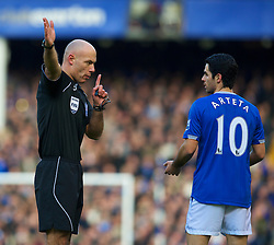 LIVERPOOL, ENGLAND - Saturday, February 20, 2010: Everton's Mikel Arteta argues with referee Howard Webb over a Manchester United handball, which was not penalised by the officials during the Premiership match at Goodison Park. (Photo by: David Rawcliffe/Propaganda)