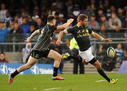 Image ©Licensed to i-Images Picture Agency. 07/06/2014. CAPE TOWN, SOUTH AFRICA -  Willie le Roux of South Africa kicks the ball away during the Castle Lager Incoming Series rugby tour match between the Springboks and the World XV at Newlands rugby stadium. Picture by Roger Sedres / i-Images