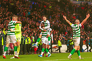 Mikey Johnston of Celtic FC jumps on Odsonne Edouard's back celebrating their teams win during the Betfred Scottish League Cup Final match between Rangers and Celtic at Hampden Park, Glasgow, United Kingdom on 8 December 2019.