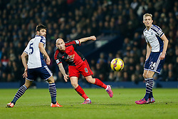 Jonjo Shelvey of Swansea City shoots past Darren Fletcher of West Brom - Photo mandatory by-line: Rogan Thomson/JMP - 07966 386802 - 11/02/2015 - SPORT - FOOTBALL - West Bromwich, England - The Hawthorns - West Bromwich Albion v Swansea City - Barclays Premier League.
