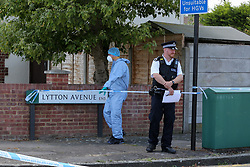 © Licensed to London News Pictures. 17/07/2020. London, UK. A forensic officer on Lytton Avenue, Enfield, in north London as police launch a murder investigation following the death of a man in his 30s. Police were called at 04:45hrs on early this morning,Police were called at 04:45hrs early this morning, to a report of four men fighting in Lytton Avenue, Enfield and a man being put into a vehicle. Later the victim died from a single stab wound in North Middlesex Hospital. Three men, no further details, have been arrested on suspicion of murder; all remain in custody. Photo credit: Dinendra Haria/LNP