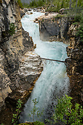 """Marble Canyon embraces Tokumm Creek just above its confluence with the Vermilion River, at the north end of Kootenay National Park in the Canadian Rockies of British Columbia, Canada. For over 500 million years before tectonic forces thrust up the Rocky Mountains, a shallow tropical sea deposited carbonate sediments that became the limestone and dolomite rock seen in Kootenay's """"Marble Canyon."""""""