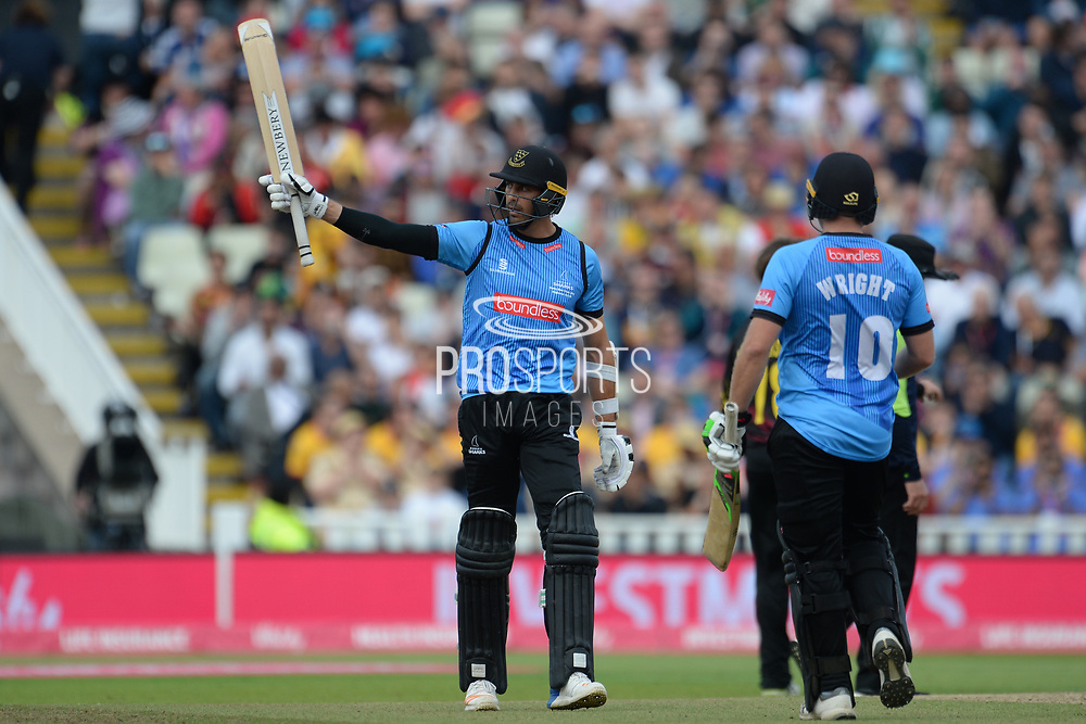 David Wiese of Sussex raises his bat on reaching his half-century during the Vitality T20 Finals Day semi final 2018 match between Sussex Sharks and Somerset County Cricket Club at Edgbaston, Birmingham, United Kingdom on 15 September 2018.