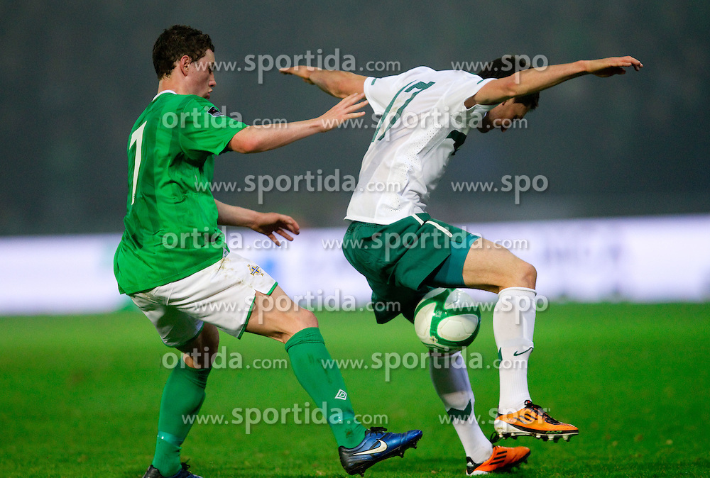 Corry Evans of Northern Ireland vs Andraz Kirm of Slovenia during EURO 2012 Quaifications game between National teams of Slovenia and Northern Ireland, on March 29, 2011, in Windsor Park Stadium, Belfast, Northern Ireland, United Kingdom. (Photo by Vid Ponikvar / Sportida)