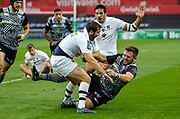 Scott Otten of Ospreys tackles Camile Lopez of ASM Clermont Auvergne during the European Rugby Challenge Cup match between Ospreys and ASM Clermont Auvergne at The Liberty Stadium, Swansea on 15 October 2017. Photo by Andrew Lewis.
