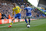 Leeds United forward Patrick Bamford (9)  goes past Birmingham City midfielder Gary Gardner (20)  during the EFL Sky Bet Championship match between Birmingham City and Leeds United at St Andrews, Birmingham, England on 6 April 2019.