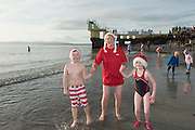 25/12/2015   Conor  and Lauren Leahy Moycullen and Grandmother Mary Dunleavy Salthill Galway taking part in the COPE annual Christmas Day swim  . Photo:Andrew Downes