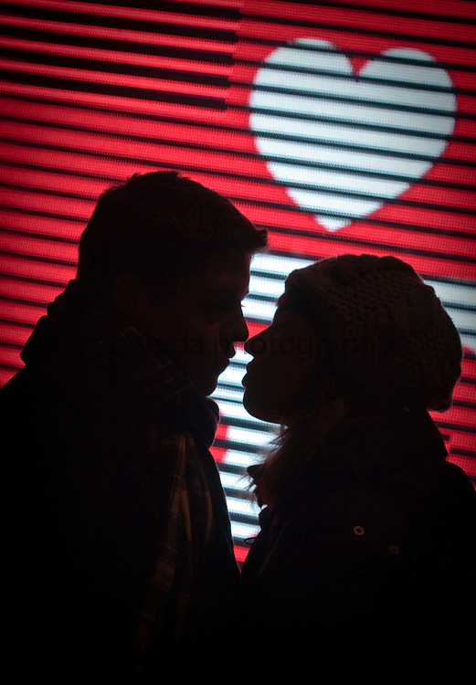 A couple kissing in the streets of Madrid