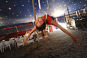 SUN-STAR PHOTO BY BEA AHBECK<br /> July Coronel, 15, practices on the rings during Carson &amp; Barnes Circus stop in Merced Tuesday, June 23, 2009.
