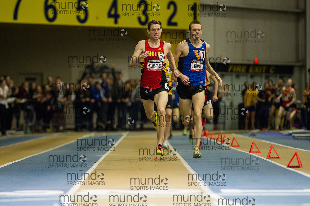 Windsor, Ontario ---2015-03-14--- Ross Proudfoot of Guelph out kicks Thomas Riva of Victoria to win the 1500m at the 2015 CIS Track and Field Championships in Windsor, Ontario, March 14, 2015.<br /> GEOFF ROBINS/ Mundo Sport Images