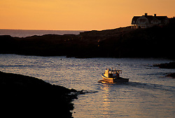 Perkins Cove, Ogunquit, ME.   A fishing boat pulls out of the cove at sunrise