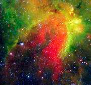 This infrared image showed a 'snake' (upper left) and its surrounding stormy environment. The object is actually the core of a thick, sooty cloud large enough to swallow dozens of solar systems. NASA's Spitzer Space Telescope.